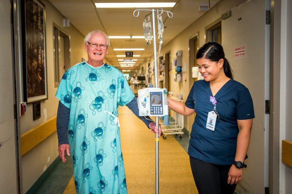 Patient & Nurse with IV Pump_web